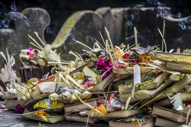 Close-up of offerings at temple