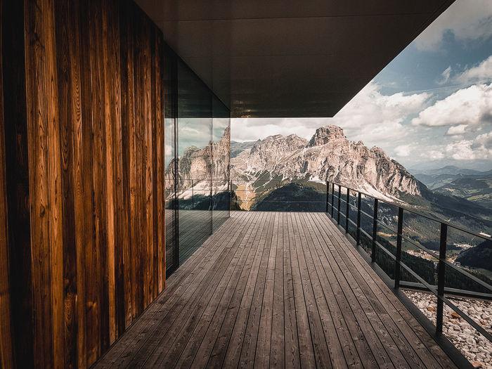 Empty corridor against sky