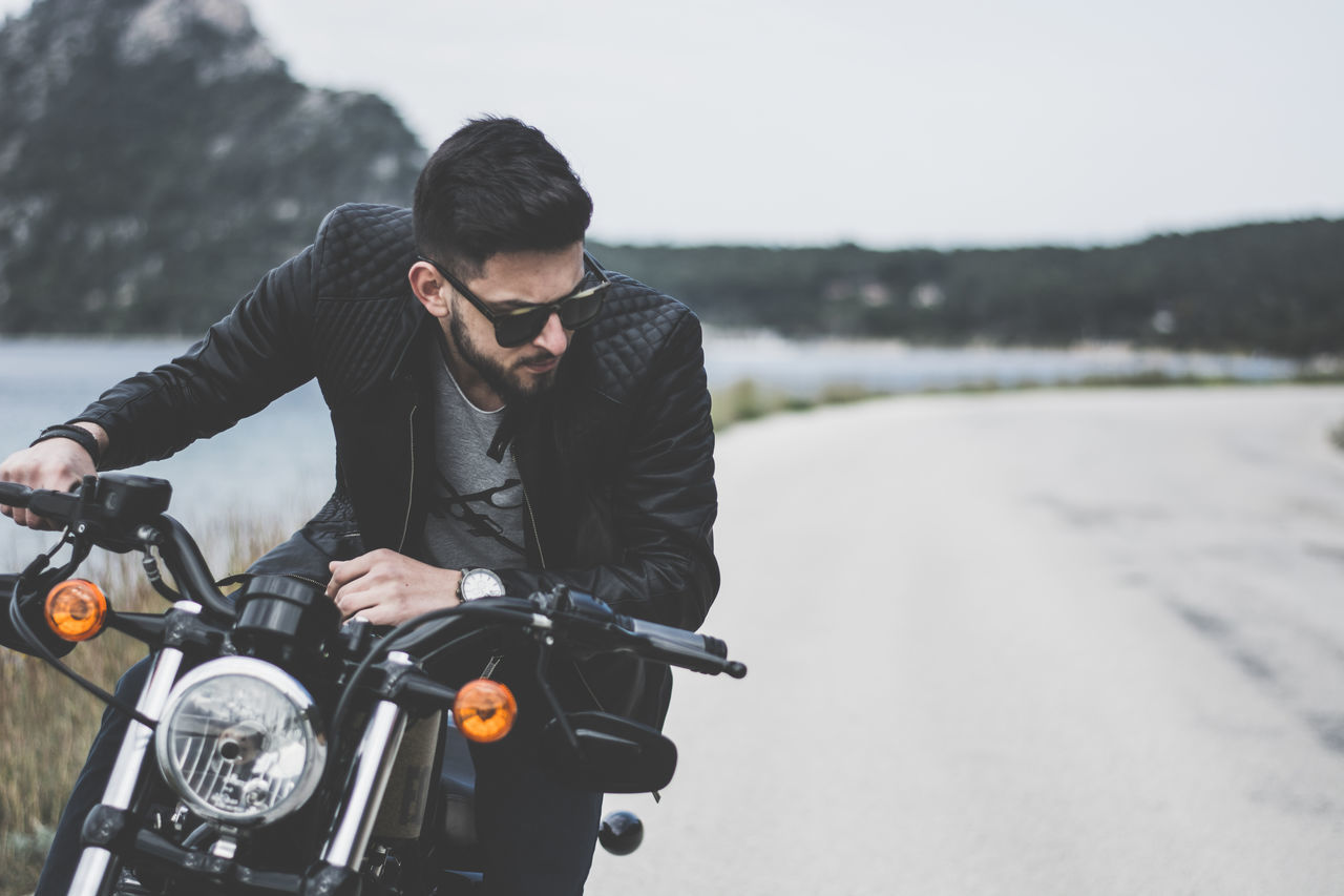 transportation, motorcycle, land vehicle, mode of transport, travel, one person, adventure, focus on foreground, day, road, outdoors, men, biker, nature, young adult, sky, adult, people
