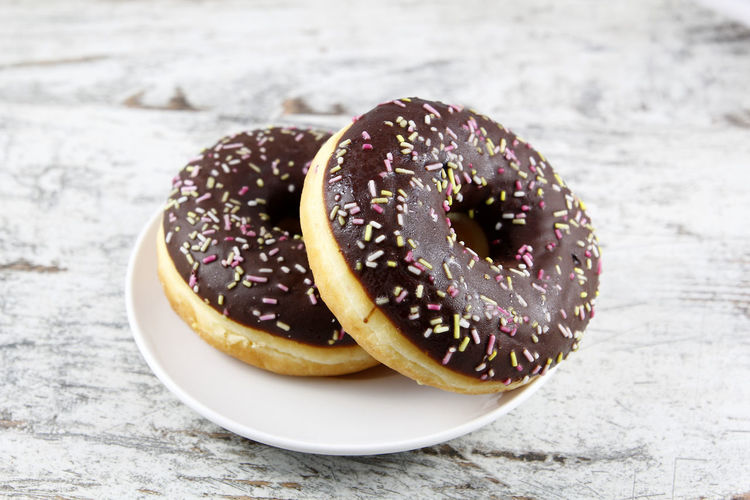 Blank billboard outdoors, in a public zone Donut Doughnut Background Glazed Sprinkles Sugar Sweet Breakfast Bakery Pastry Dessert Icing Diet Snack Calories Food Cake Taste Flavor Eat Chocolate Fat Colorful Frosting Dough Round Delicious Top Dish Plate Wood Wooden Tasty Two