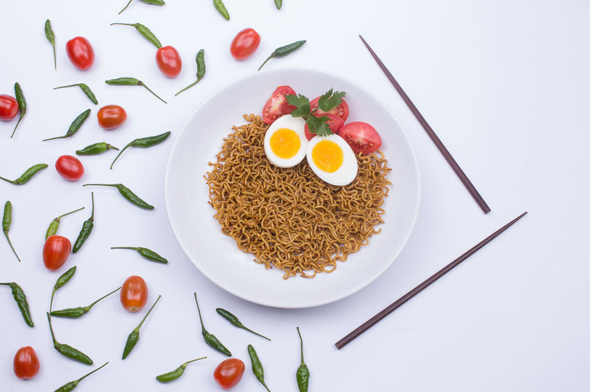 Fried noodle on a white plate styled beautifully Fried Noodles Noodles Breakfast Directly Above Egg Food Food And Drink Freshness Healthy Eating High Angle View Indoors  Love Meal No People Noodle Plate Positive Emotion Ready-to-eat Serving Size Still Life Studio Shot Table Temptation Wellbeing