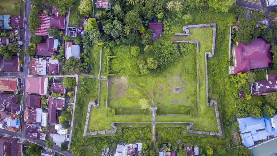 Aerial view of grass field amidst houses