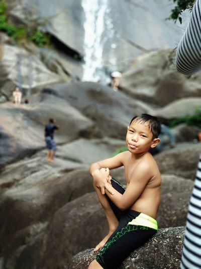 H A P P Y - His first ever experience with waterfall and loves it at Telaga Tujuh Waterfalls, Langkawi. Hiking Hiking Adventures Swimming Trunks Travel Travel Destinations Waterfall Jungle Trekking Child Potrait Rock - Object Rocky Mountains Beauty Beautiful People Flowing Water Falling Water