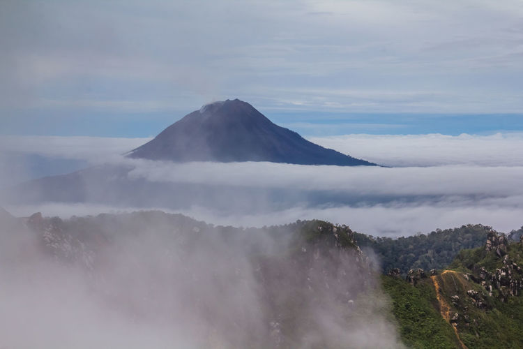 Gunung Sinabung Volcano Cloud Sinabung Sunlight Active Beauty In Nature Cloud - Sky Day Fog Forest Gunung Haze Hazy  Landscape Mist Mount Mountain Mountain Range Nature No People Outdoors Power In Nature Scenics Sibayak Sky Sunrise Tranquil Scene Tranquility Travel Destinations Volcanic Landscape Volcano