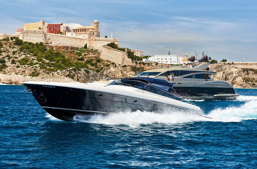 Ibiza, Spain - June 10, 2017: Vew to the famous castle of Ibiza Dalt Vila and motorboat. Ibiza, Balearic Islands. Spain. Ibiza Mediterranean Sea Old Town SPAIN Balearic Islands Boat Dalt Vila Famous Place Fort Fortification Fortress Ibiza Old Town Island Motion Motorboat Nature Nautical Vessel Outdoors Sea Sky Speed Travel Destinations Water Waterside Waves