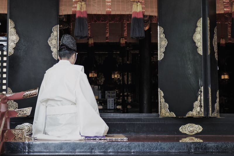 Real People Rear View One Person Architecture Place Of Worship Belief Religion Adult Built Structure Traditional Clothing Spirituality Lifestyles Men Building Women Leisure Activity Standing Day Hairstyle