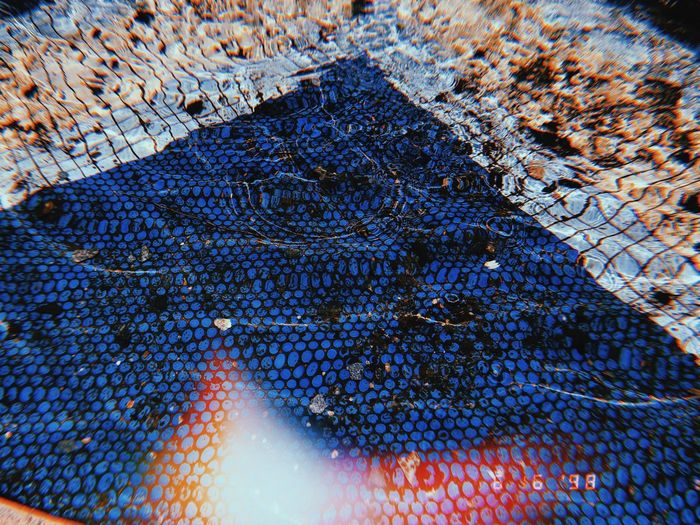 Blue No People Pattern Close-up Nature Day Textured  Outdoors Low Angle View Sunlight Multi Colored Full Frame Backgrounds Reflection Solid Land Design Metal
