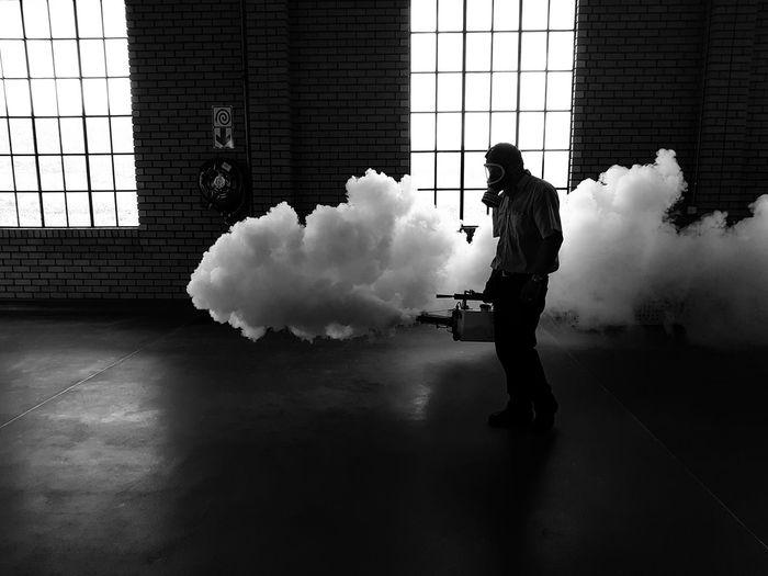 Person fogging a building