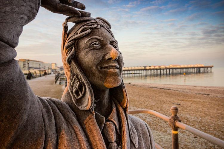 Close-up of statue in sea