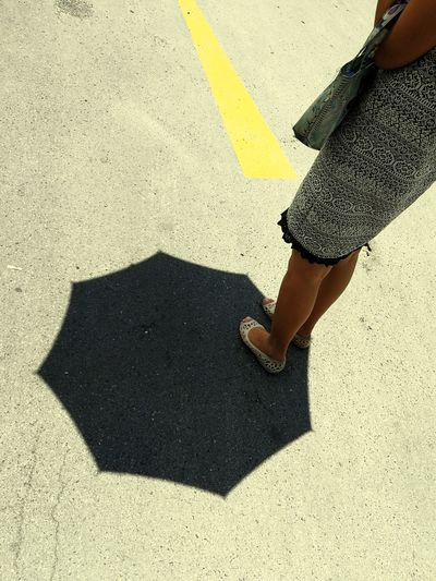 Low Section Human Leg Shadow High Angle View Human Foot Lifestyles Human Body Part Women One Person Sunlight Street Day Shoe Real People Road Leisure Activity Asphalt Standing Outdoors Only Women Umbella Abstract Backgrounds Full Frame Pattern Texture