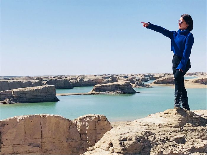 Don't stop,the world is at your feet. Yardang Landform Standing Lifestyles One Person A New Beginning Beauty In Nature
