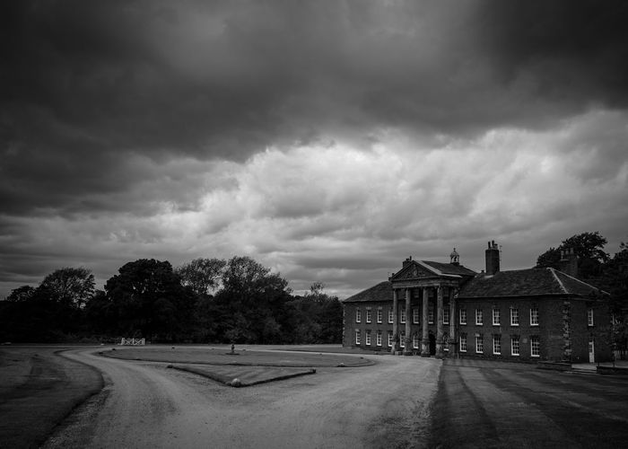 Cloud - Sky Sky Building Exterior Built Structure Architecture Outdoors Road Tree The Way Forward No People Day Storm Cloud Nature Stately Home Historic Historic Building Storm Stormy Stormy Weather Showers Black And White Black And White Photography Monochrome
