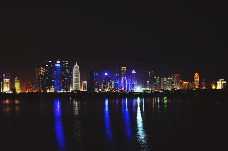 Night In Qatar Qatar Bay City Night Architecture Illuminated Reflection Cityscape Building Exterior Skyscraper Urban Skyline Built Structure Modern Waterfront Water River Sky City Life No People Outdoors Downtown District Nature