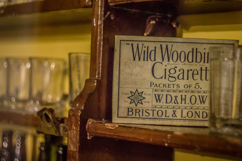 Book Cigarette  Cigarette Break Cigarette Time Cigarettes Cigarrette Close-up Communication Fags Focus On Foreground Glass - Material Indoors  Metal Non-western Script Old Old-fashioned Selective Focus Shelf Smoke Smoking Still Life Table Text Western Script Wild Woodburn
