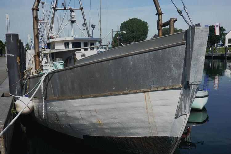 View of fishing boats moored at harbor