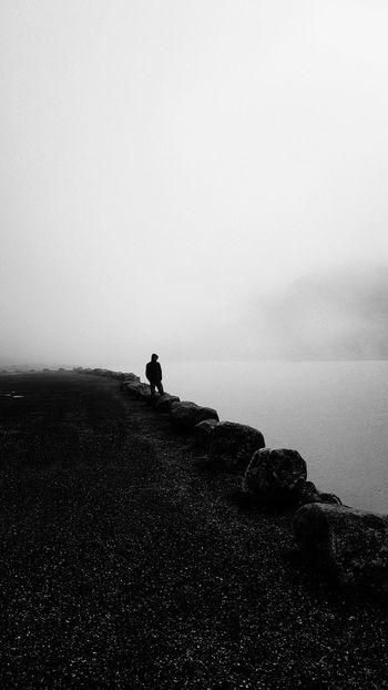 ...a man alone in the fog Mountain Only Men Blackandwhite Norway🇳🇴 Norge Norway Summer2018 Rain Lake Ski Fog Full Length Water Standing Coast