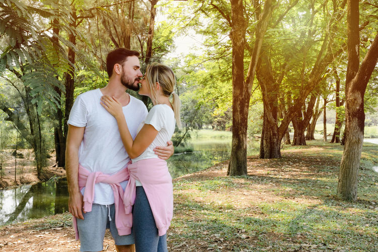 Happy young couple standing on land