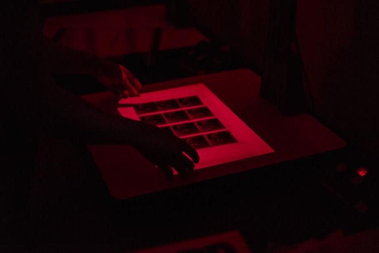 Dark Room Film Negative Dark Development Film Photography Human Body Part Human Hand Indoors  Red Red Light