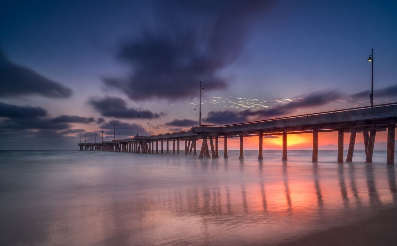 sunset, bridge - man made structure, sky, water, connection, cloud - sky, architecture, built structure, sea, dusk, outdoors, waterfront, nature, beauty in nature, suspension bridge, scenics, travel destinations, tranquility, no people, building exterior, day