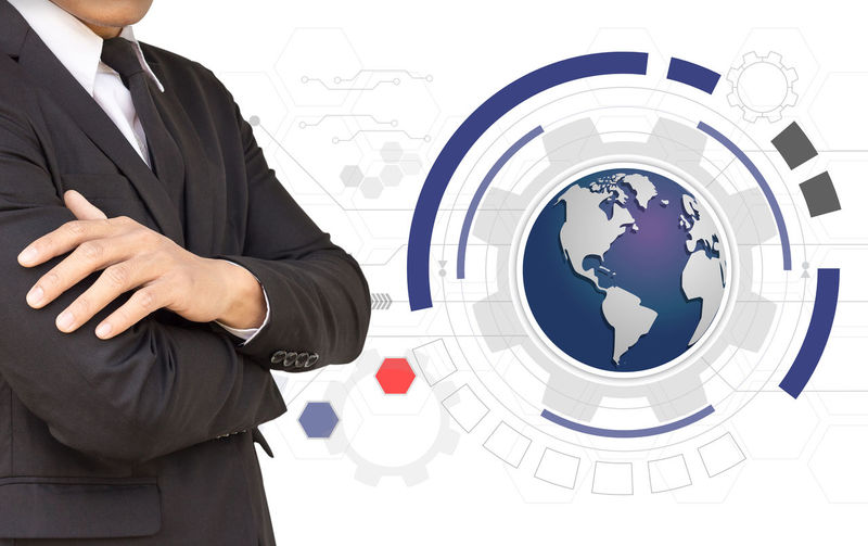 Digital composite image of businessman standing by globe against white background