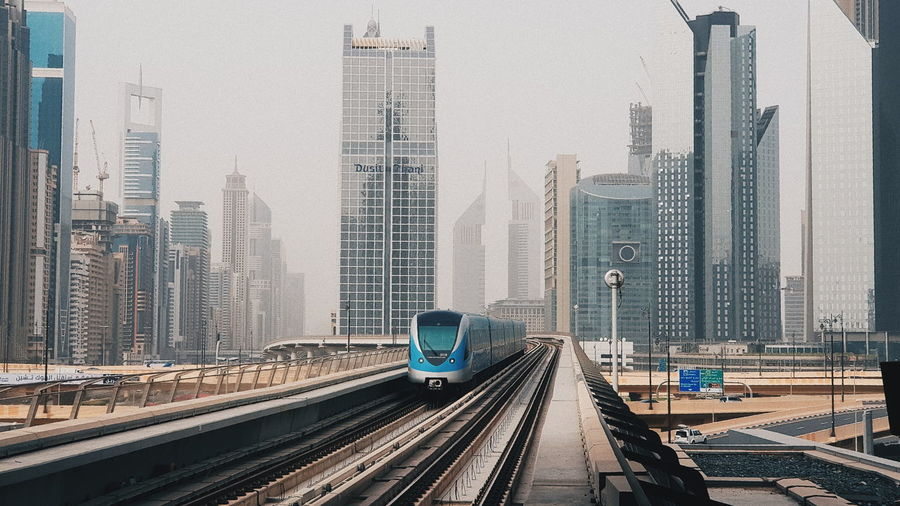 Architecture City Building Exterior Rail Transportation Transportation Built Structure Railroad Track Track Mode Of Transportation Train Office Building Exterior Public Transportation Skyscraper Building Sky Tall - High Train - Vehicle Day Tower No People Cityscape Outdoors Modern Financial District