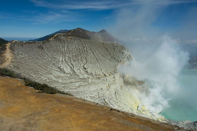 Scenic View Of Smoke Emitting From Hot Springs At Ijen