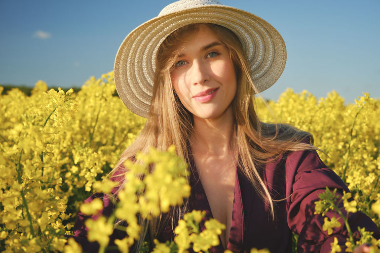 Portrait of a smiling young woman in field