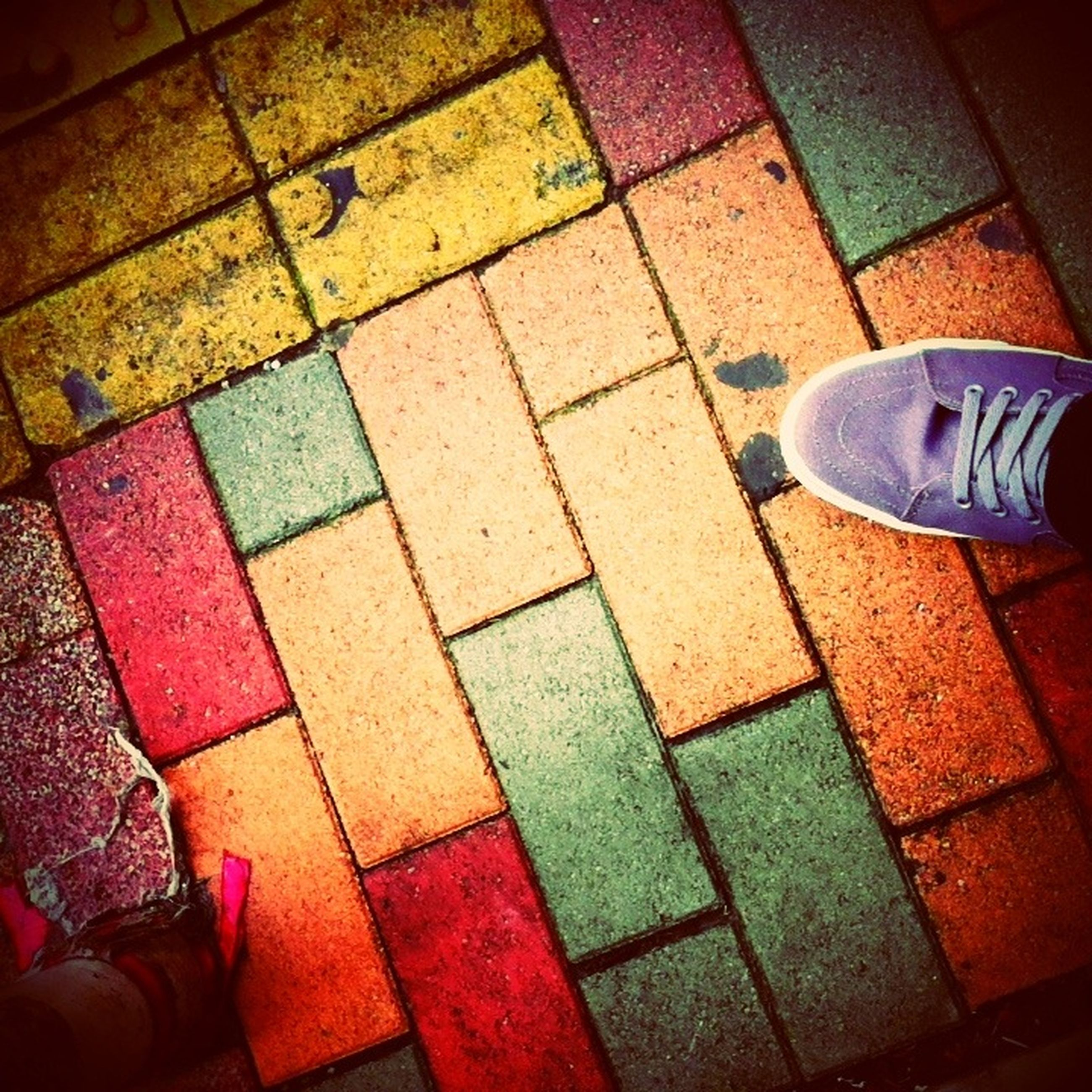 high angle view, tiled floor, low section, flooring, paving stone, pattern, cobblestone, shoe, indoors, person, floor, tile, footpath, red, pavement, side by side, directly above, standing, empty, shadow