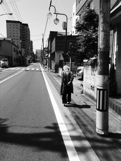 Woman Walking At City Street