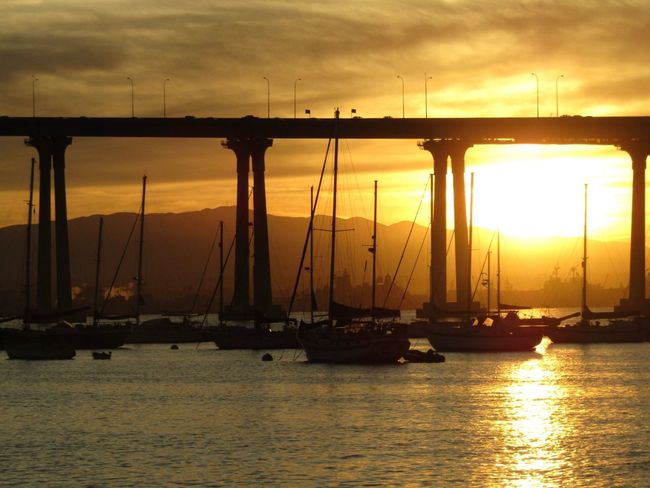 California USA California Coast California Sunrise Coronado Transportation Nautical Vessel Water Sky Mode Of Transport Mast Silhouette Sea Outdoors No People Waterfront Nature Bridge - Man Made Structure Sailboat Travel Destinations Harbor Scenics Beauty In Nature Sailing Ship