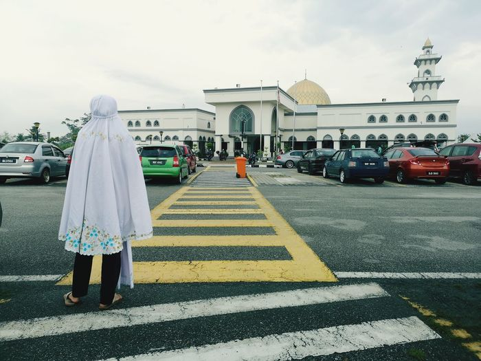 Walking way for Aidulfitri prey at mosque. Prey Young Women Prey Aidulfitri Mosqueinmalaysia Attraction City Full Length Sky Architecture Built Structure Vehicle Street White Line Yellow Line Road Marking Zebra Crossing Parking Street Scene Asphalt