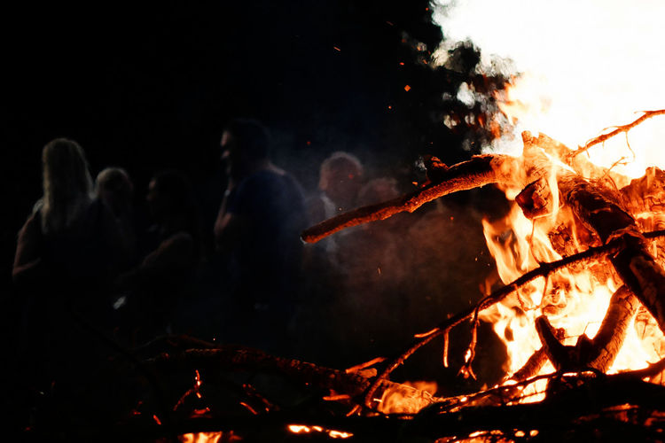 Bonfire Burning Fire - Natural Phenomenon Firefighter Flame Glowing Heat - Temperature Men Night Outdoors People Real People Smoke - Physical Structure Teamwork Enjoy The New Normal