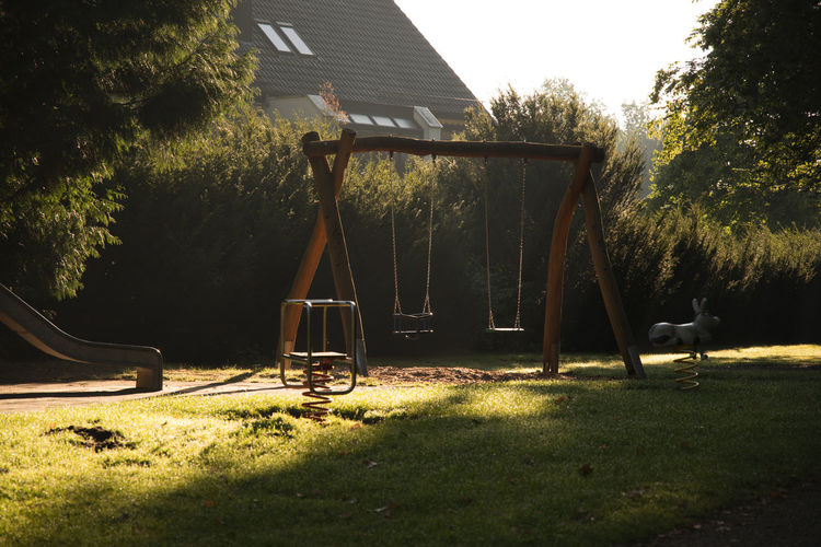 Playground equipment in park during sunny day