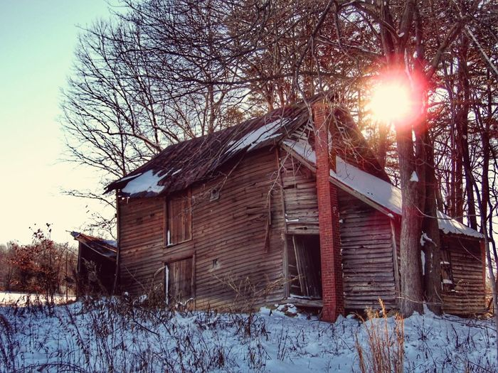 I've shot this barn numerous times because I'm documenting it's slow demise. It is caving in to it's cellar and each storm or snow event makes it slide a little further into the hole. I'm not sure how many more storms it will hold up to. Abandoned House Old Barn Collapsing Structure Falling Down Snowscene Winter_collection Shades Of Winter Decay Country Scenery Rural Exploration Abandoned America Abandoned Barn Sunlight Thru Trees Snow Winter Cold Temperature Built Structure Building Exterior Wood - Material Architecture Abandoned Barn Nature Rural Scene Sunlight Day No People Tree