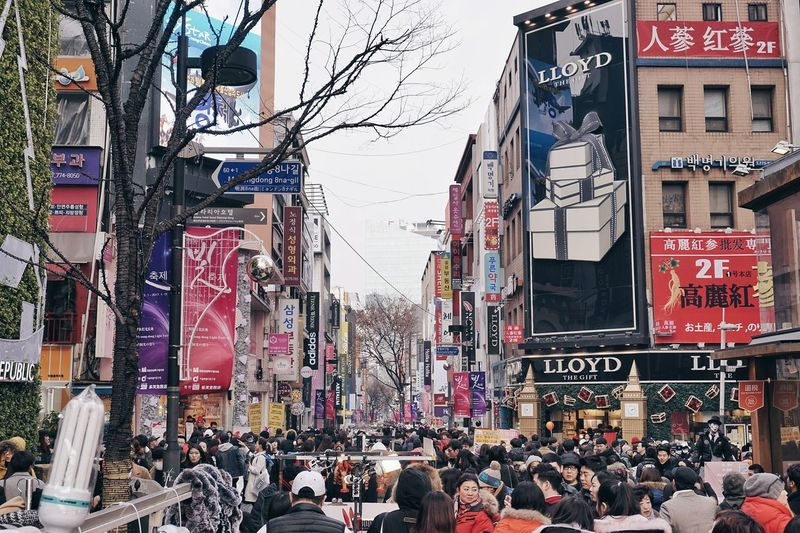 Christmas in Myeongdong Large Group Of People Crowd Travel Destinations City Outdoors Building Exterior Flag Text People Architecture Day