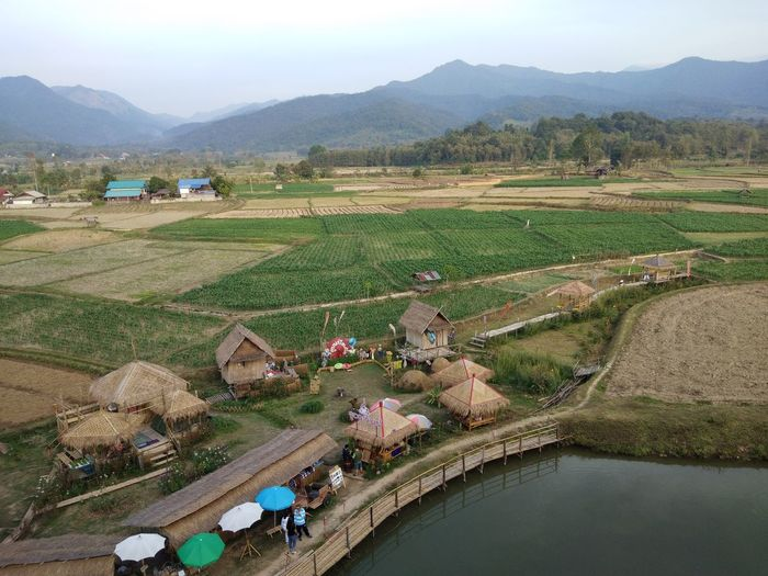 High angle view of people on agricultural field against sky