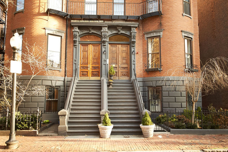 Architecture Balcony Building Building Exterior Built Structure Culture Day Exterior Geometry Historic History Leading Modern Potted Plant Railing Residential Structure Staircase Steps Steps And Staircases Symmetry Wall Window