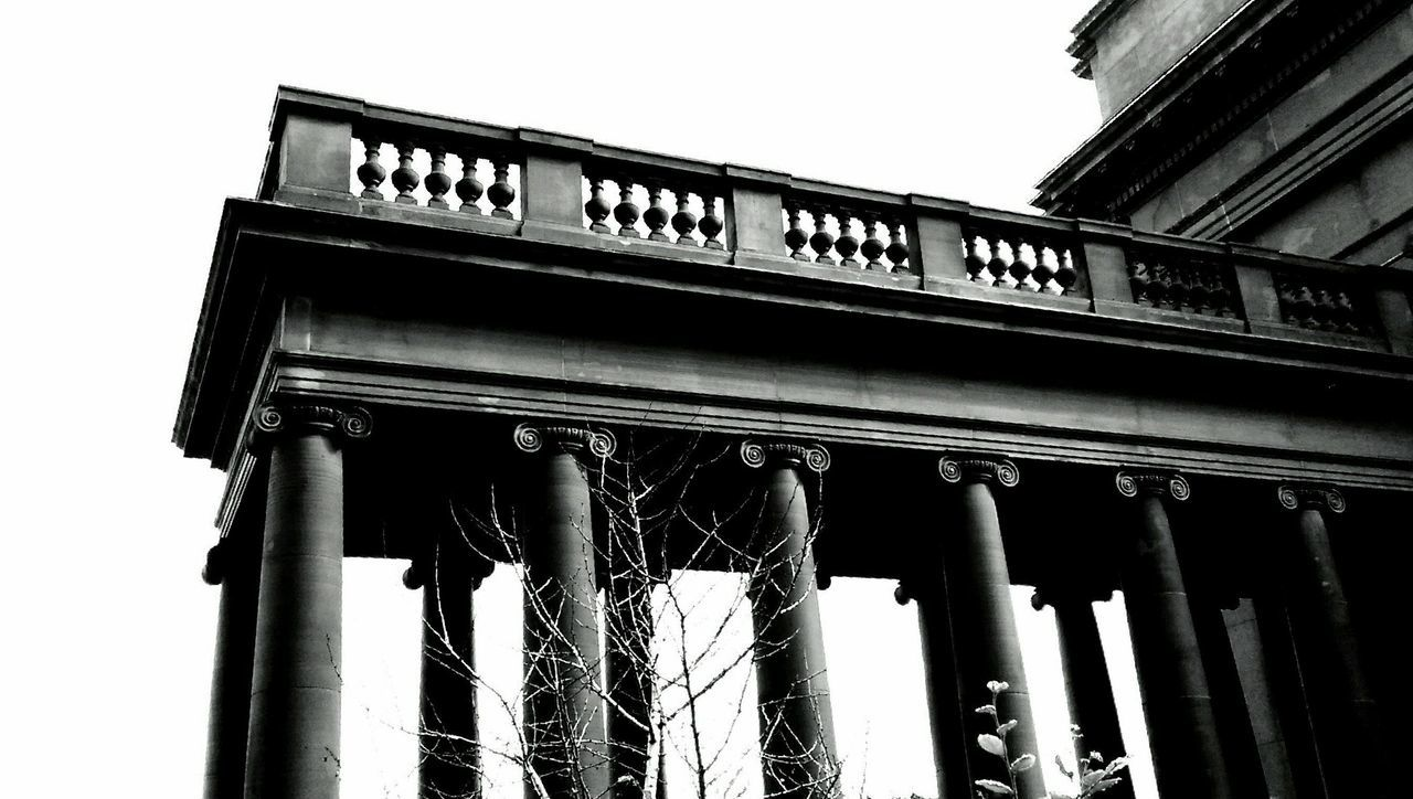 architecture, low angle view, built structure, architectural column, text, building exterior, communication, day, no people, outdoors, sky
