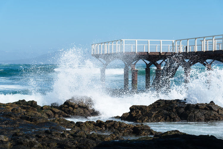 Waves splashing against pier and rocks Canary Islands Fuerteventura Pier Surf Aquatic Sport Beauty In Nature Breaking Crash Day Force Hitting Jetty Motion Nature No People Outdoors Power Power In Nature Rock Rock - Object Sea Sky Splashing Water Waves