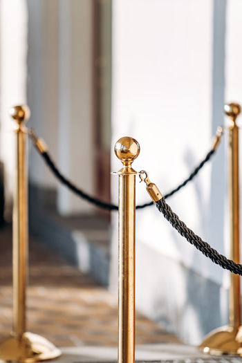 Close-up of rope tied on metal railing