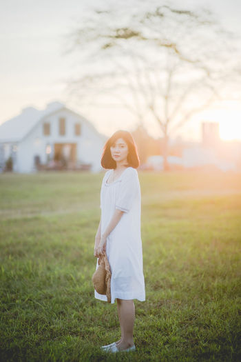 Beautiful Woman Beauty In Nature Casual Clothing Day Field Focus On Foreground Full Length Grass Happiness Leisure Activity Lifestyles Nature One Person Outdoors Portrait Real People Sky Smiling Standing Tree Walking Wedding Dress Women Young Adult Young Women