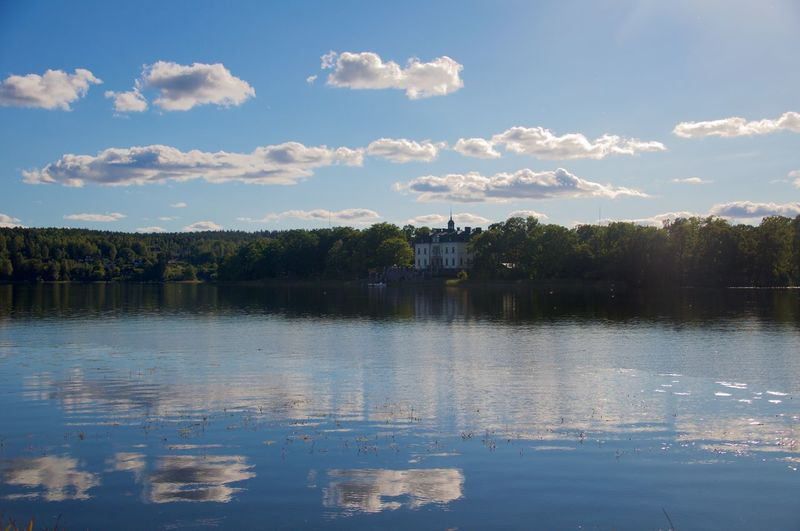 Gripsholm Castle By Lake Against Cloudy Sky