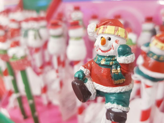 Close-up of santa claus figurine at market stall