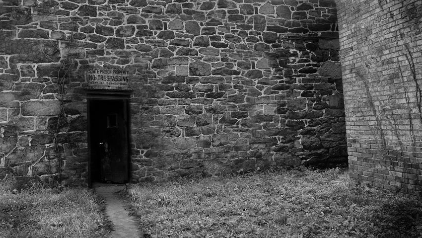 Prison rear entrance Abandoned Architecture Brick Brick Wall Building Building Exterior Built Structure Day Door Doorway Entrance History House No People Old Outdoors Prison Stone Wall The Past Wall Wall - Building Feature