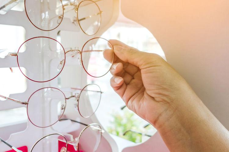 Close-up of hand holding eyeglasses