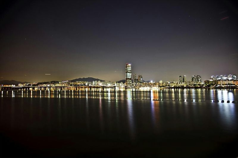 Cities At Night Han River Night View Seoul, Korea Buildings Are Progected Up On The River Reflections In The Water