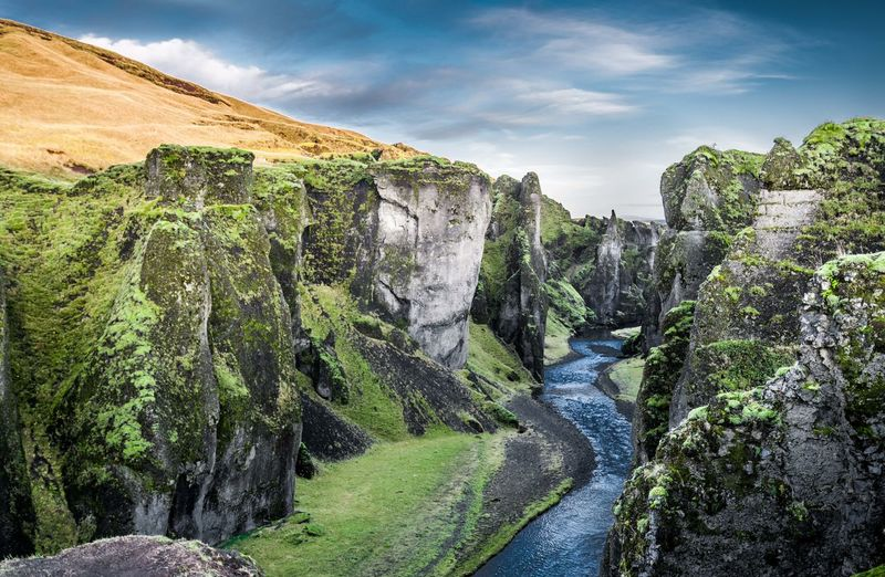 Fjaðrárgljúfur canyon in November. Southeastern Iceland. Blue Water Blue River Canyon Contrasting Colors Green Yellow Blue Fjaðrárgljúfur Fjadrargljufur Fjaðrárgljúfur Canyon Iceland Iceland_collection Sony A7RII Nature_collection Nature Photography EyeEm Nature Collection Eyeem Nature EyeEm Nature Lover Scenics - Nature Rock Beauty In Nature Nature Rock - Object Solid No People Tranquil Scene Environment Tranquility Plant Sky Day Cloud - Sky Rock Formation Mountain Non-urban Scene Tree Outdoors Green Color Flowing Water Formation Hiking Hiking Adventures Travel Destinations Travel Photography EyeEm Travel Photography Wild Places The Great Outdoors - 2019 EyeEm Awards