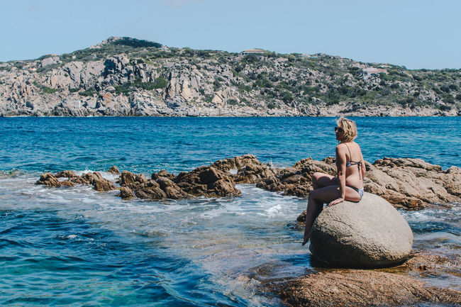 Swimming in Sardinia Alone Holiday Relaxing Vacations Woman Beauty In Nature Bikini Day Full Length Girl Leisure Activity Mermaid Nature Ocean One Person Outdoors Real People Rock - Object Rock Pools Sea Summer Swim Water Water Collection  Young Adult