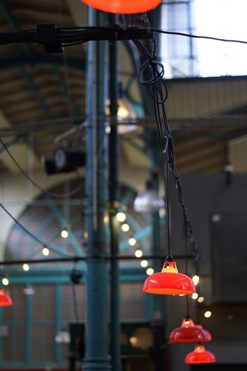 Markthalle Neun Markthalle Neun Hanging Illuminated Focus On Foreground Lighting Equipment Built Structure Architecture No People Building Exterior Electricity  Building Metal Light Close-up Cable Electric Light Outdoors Red Low Angle View Pendant Light Ceiling Electric Lamp