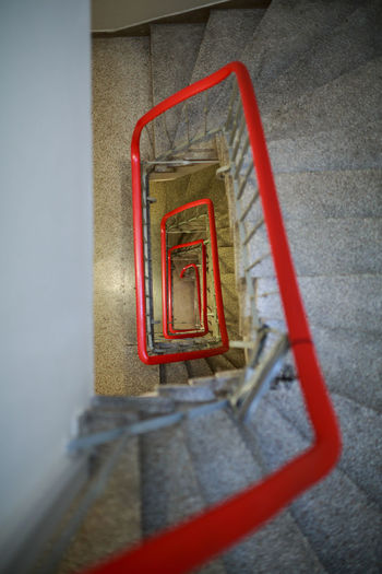 High angle view of red staircase in building